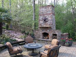 outdoor living room area fireplace paver patio stone walkway