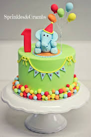 A Colourful Circus Themed First Birthday Cake Featuring An Elephant