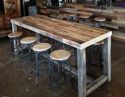 reclaimed all wood community bar dining tables are hand made and one of a kind the table top is well sanded sealed but you will find rustic character pub i13