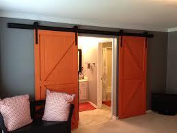 interior sliding barn door. Interior Sliding Barn Door For Bathroom With White Vanity Orange Floormat Under Stainless Steel
