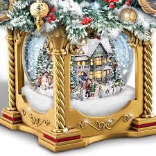 Lighted Globe Led Revolving Tree Topper The Thomas Kinkade Snow Globe Tabletop Tree Hammacher