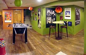 cool ideas for man cave decor green painted wall brown wood floor round table high bar stools ball hanging lantern black table football