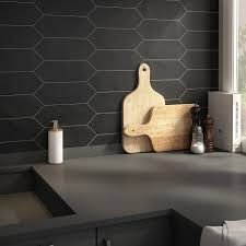 merola tile with black wall and table in kitchen