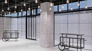 neri hu uses translucent glass blocks for walls of bright and flexible function room in beijing