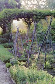 English Kitchen Garden Love The Border Around Garden Softens Square Plot And Rustic Bean