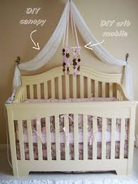 Leahs nursery DIY canopy (2 white curtains from target sewn together and  draped with hooks