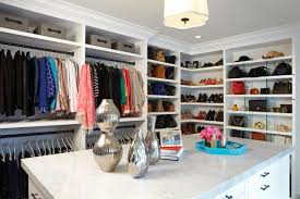 walk in closet with space for designer clothes