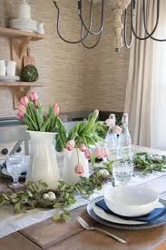 a modern farmhouse spring table setting with blue and white porcelain pink tulips and a