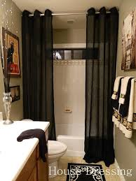 Floor-to-ceiling shower curtains...make a small bathroom feel more