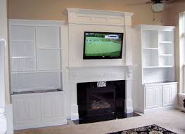 double mantel with base cabinets and shelves by tom