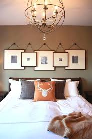 bedroom artwork above bed layered art above bed bedroom decor ideas above bed