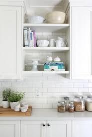 home depot subway tile backsplash, white shaker cabinets, white quartz  countertop, open cookbook shelves