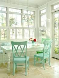 love the colored chairs with white table
