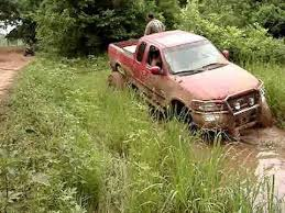 ford trucks stuck in mud. ford 4x4 mud truck on tractor tires stuck deep pulled out by chevy k5 blazer youtube ford trucks stuck in mud s
