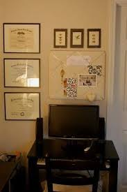 office wall frames. triple diplomas in classic slender black frames are perfectly offset by the art office wall