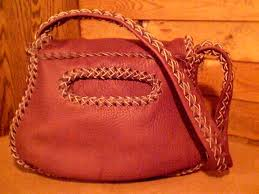 this picture is of the back view of the purses showing it s back pocket and a