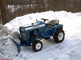 ford lgt 100 plowing snow with front mounted blade