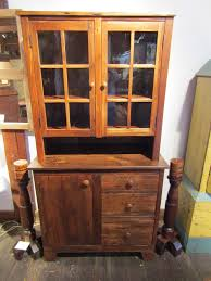 2 piece hutch made from antique pine with 3 drawers and 1 door in the base top features 3 shelves and two glass doors 38 1 4 wide x 19 3 4 deep x 74 tall