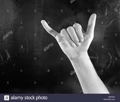 Hand On Black Background Fingerspelling The Letter Y In Sign