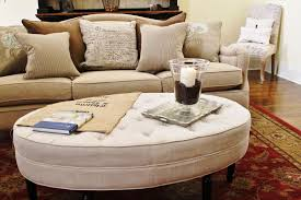 tufted round coffee table ottoman and tray with sectional sofa also throw pillows area rug accent armless chair complete your living room decor footstool