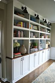 DIY built in bookcases butcher block- used upper cabinets for bases. 12  inches deep