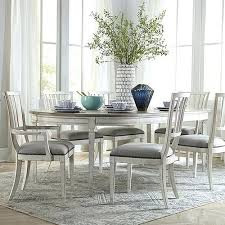 round dining table 48 inch seats how many