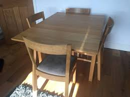 ikea bjursta extending dining table and four solid oak ikea dining table and chairs round