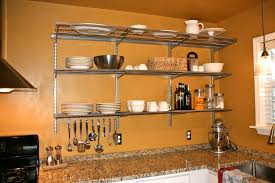 fancy alumunium wall mounted open shelving with glass top tier over marble countertops as decorate in orange kitchen ideas