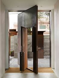 Corten Steel Pivoted Front Door With Inset Swing Door - Exterior pivot door