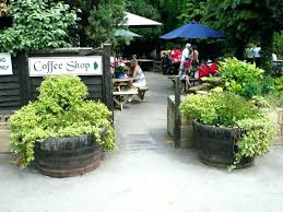 oak barrel planters we garden tubs water features bench canada barrel planters for oak canada