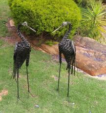 blue twisted crane garden sculpture