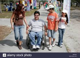 hispanic family activities. Miami Florida Kendall Family Festival Of The Arts Disabled Children Activities Hispanic Father Wheelchair