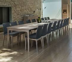 contemporary very very long dining table able to seat 20 people