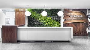 OFS Brands | Green wall, waterfall, materials, reception desk