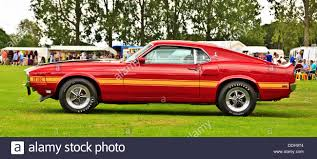 Side body of a red Ford Shelby GT350 Mustang from 1974, American ...