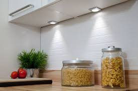 discreet under cabinet spot lights add task lighting as well as interest to the kitchen design add task lighting