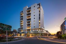 the 17 unit post tension tower includes a parking garage deck fitness center with a