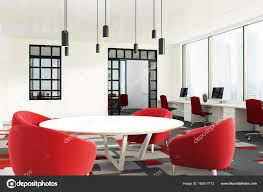 open office with round tables and red chairs stock photo
