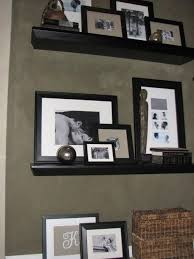 Floating Shelves For Picture Frames Best Floating Shelves Filled With Frames Frames Pinterest Shelves
