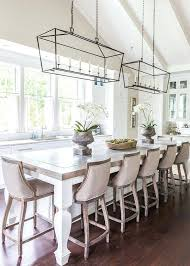 rectangular dining room lighting french style dining area in kitchen with linen covered wooden bar stools and lantern rectangular pendant lights above table