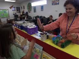 characteristics of a st century teacher  edutopia teacher giving student a high five