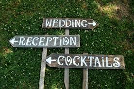 wedding reception cocktails wooden signs