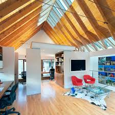 garage with office above. inspiration for a contemporary home office remodel in raleigh with white walls garage above o