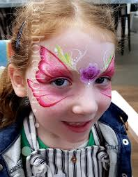 pink erfly face painting