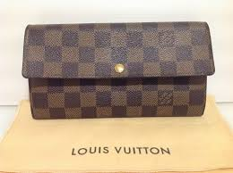 an original louis vuitton bag with accessories note that the dustbag will only have louis vuitton or lv written on it nothing more