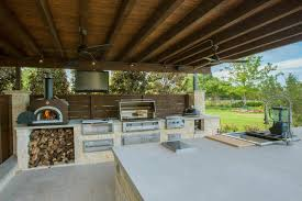 modern outdoor kitchen with pizza oven