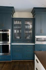 blue china cabinet with leaded glass doors
