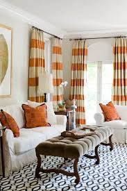 orange striped curtains with blue patterned rug really love the orange stripes