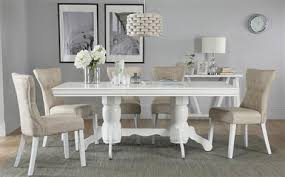 chatsworth white extending dining table with 6 bewley oatmeal chairs