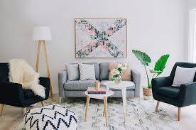 Cozy Large Scandinavian Living Room With Grey Sofa And Black Club Chair And  A Geometric Pattern Ottoman And Area Rug